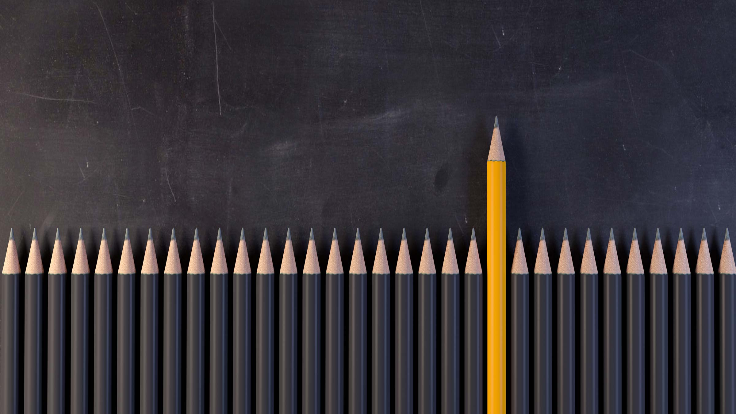 one yellow pencil standing in row of grey pencils